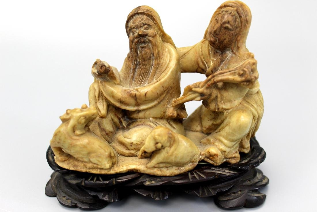 Chinese soapstone carving with wood stand.