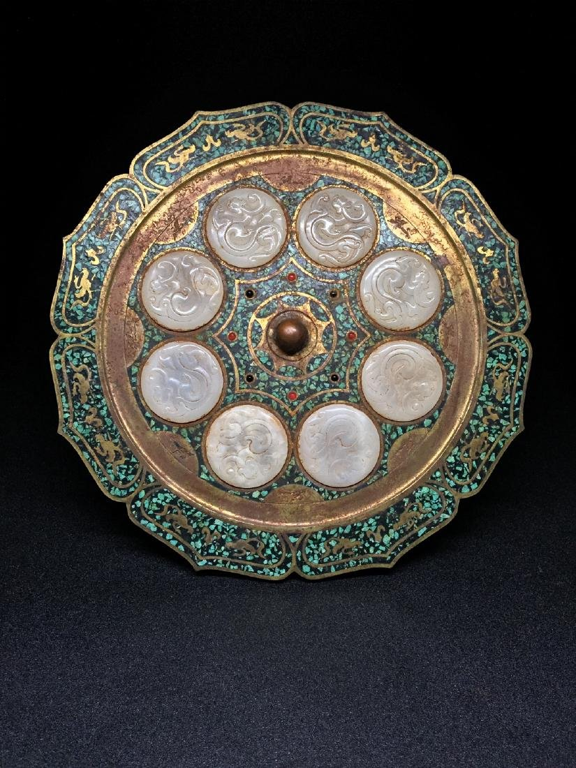Chinese metal mirror with inlaid white jade plagues.
