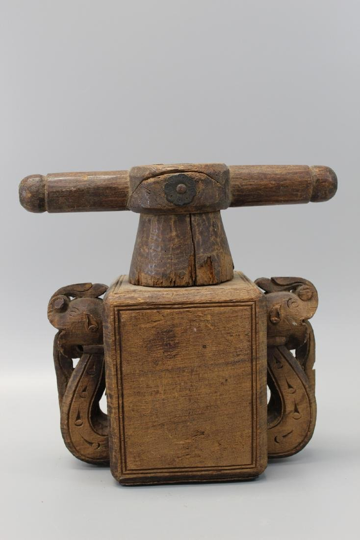 Antique Indian wood grinder or juicer.