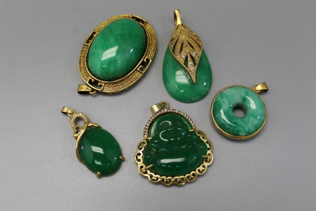 5 Chinese stone pendants.