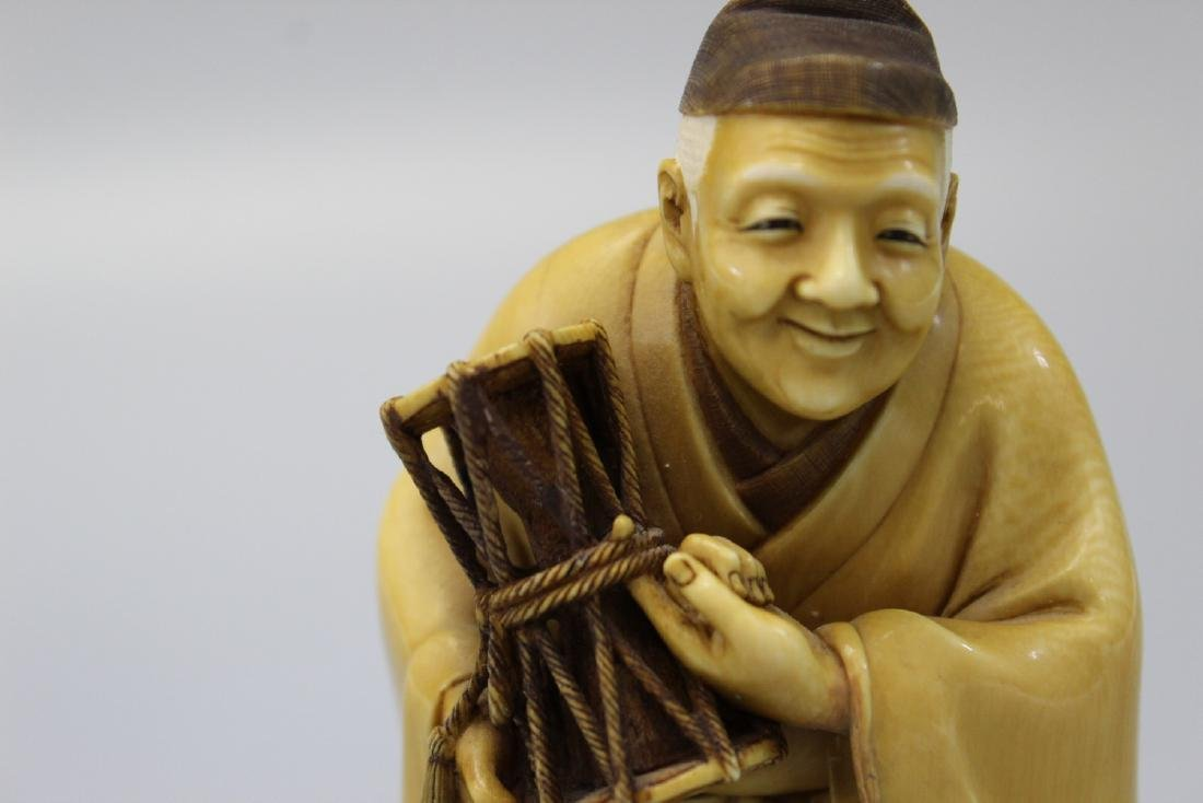 Japanese carved figurine. - 2