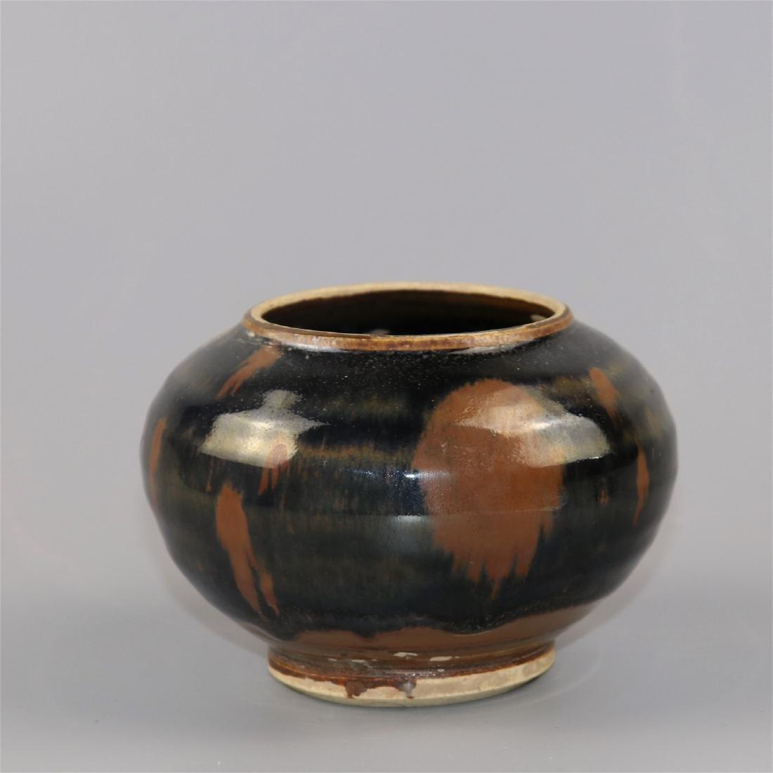Chinese black glaze pottery jar.