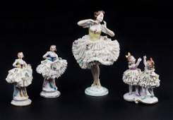 LOT OF FOUR GERMAN PORCELAIN FIGURES WITH LACE