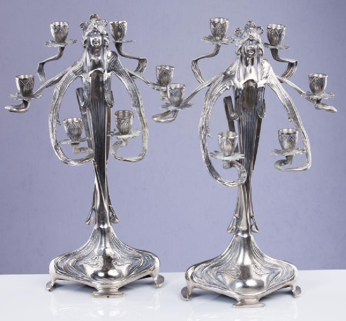 PAIR OF FIGURAL SILVER PLATED 6 LIGHT CANDLELABRA