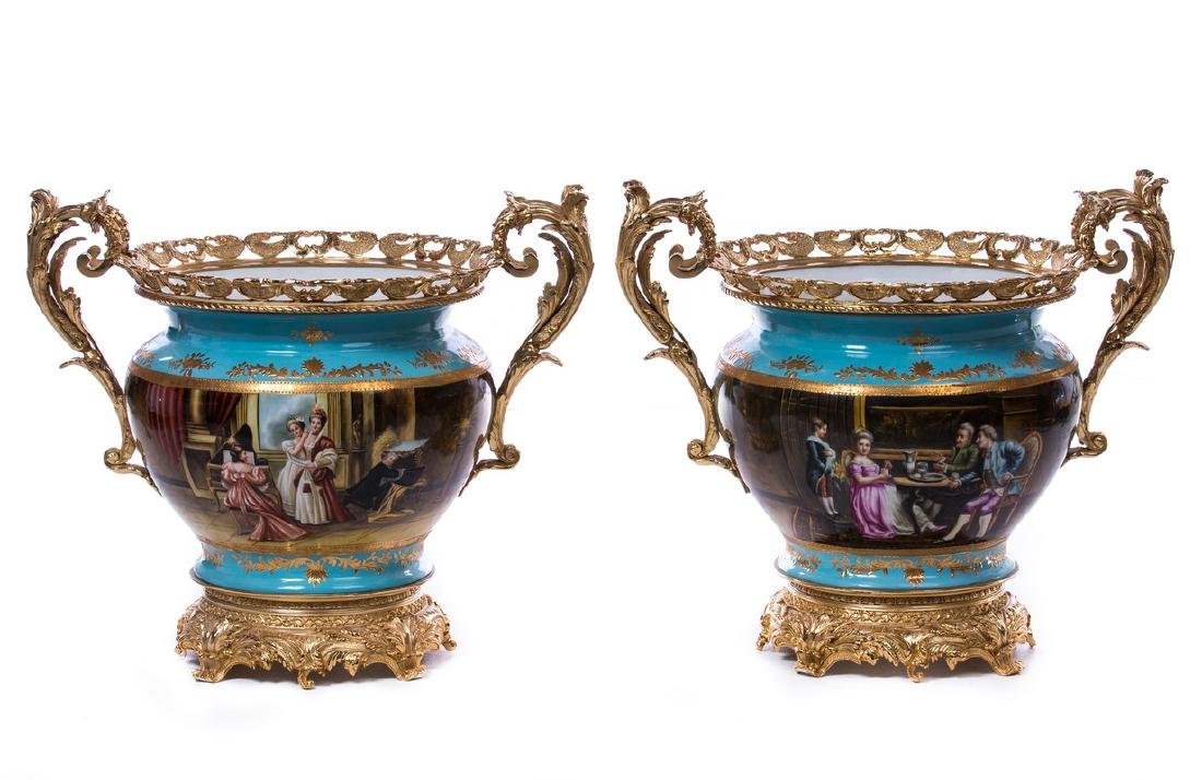 PAIR FRENCH BRONZE AND PORCELAIN CENTERPIECES