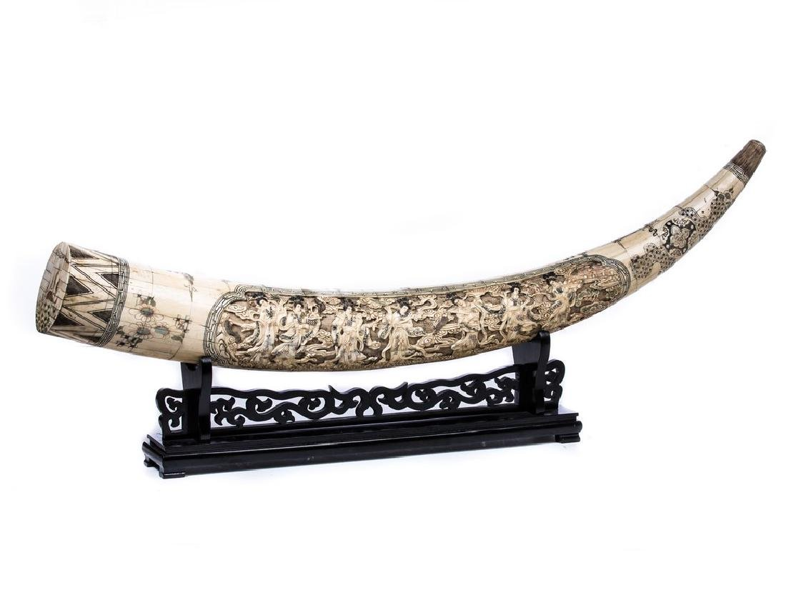 CHINESE CARVED BONE TUSK ON STAND