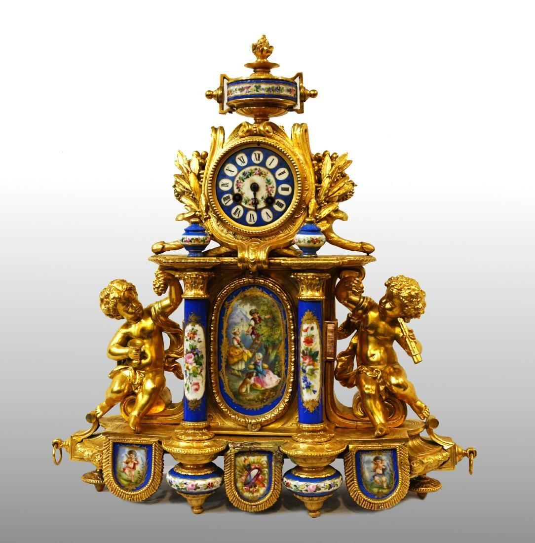 GOLDEN PENDULUM WITH SEVRÈS PORCELAIN