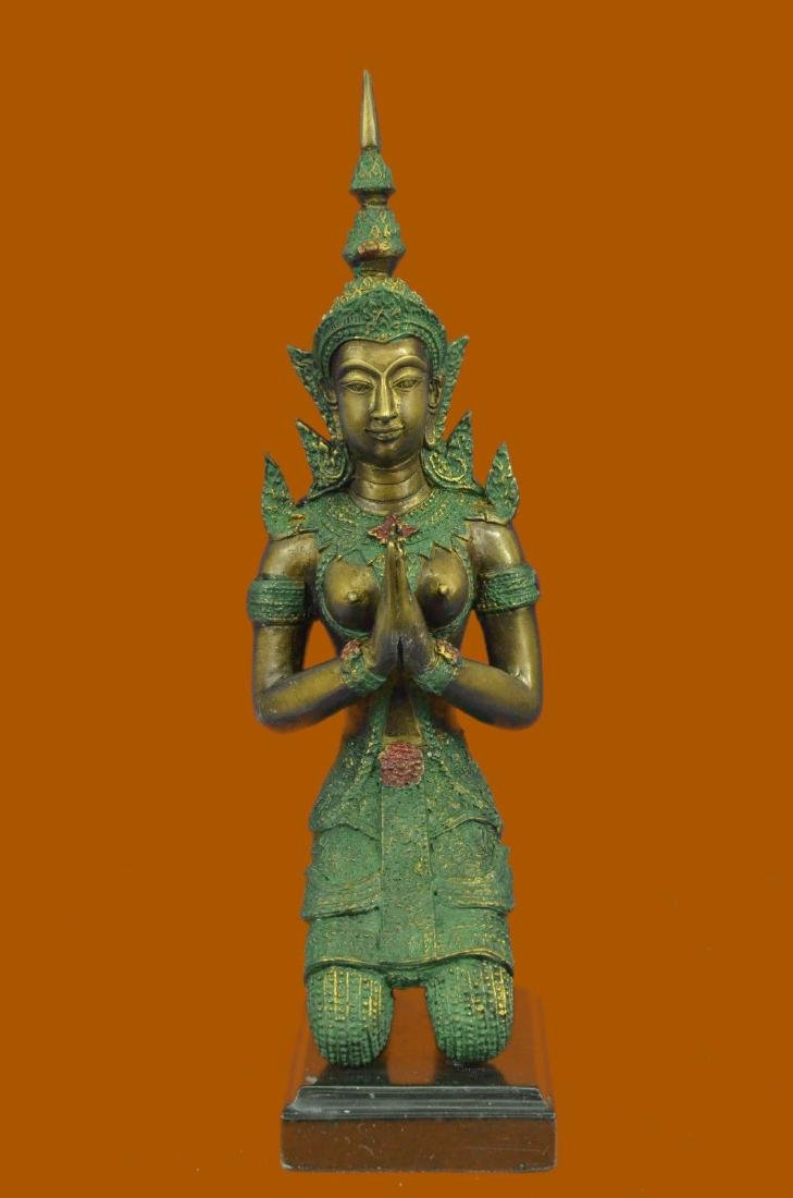 Bronze Buddhist s In Namaste And Kneeling Position