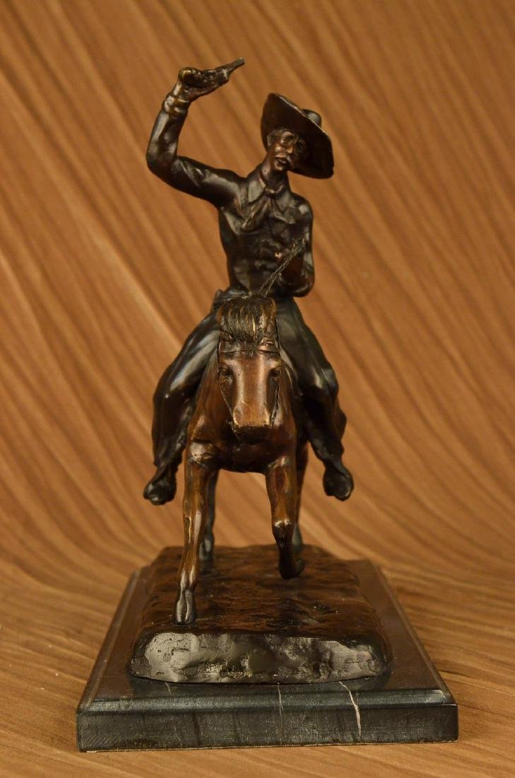 SIGNED BRONZE CHARLES RUSSELL COWBOY REVOLVER SCULPTURE