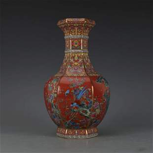 Qian Long red base hexagonal bottle with bird painting