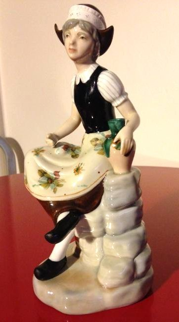 Miguel Porcelain Statue of Woman Sitting on Rock