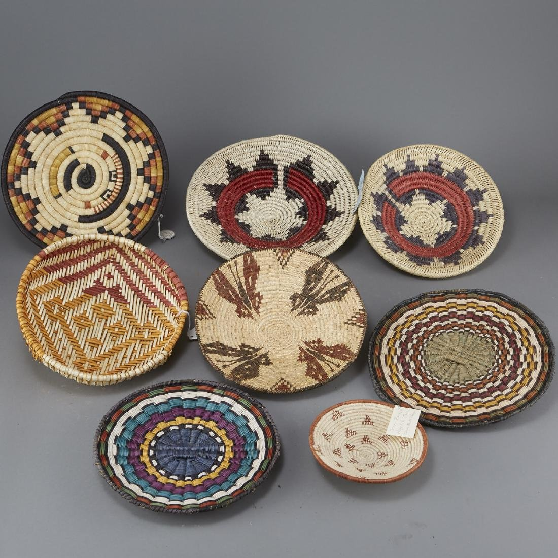 Group of 8 Native American Polychrome Woven Trays
