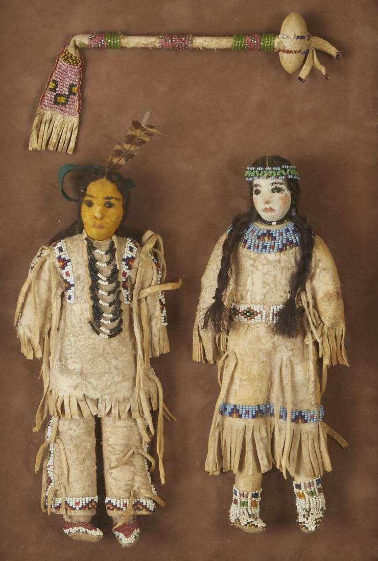 Pair of Beaded Sioux Dolls with Club Provenance