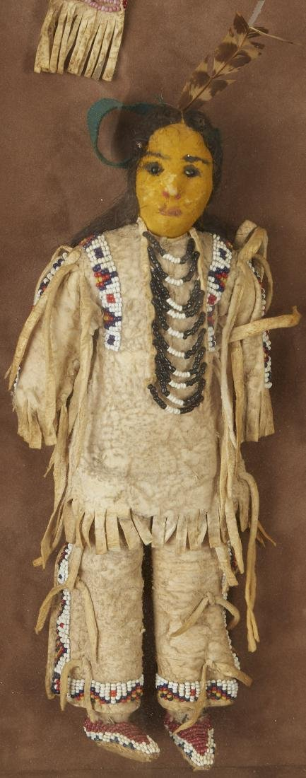 Pair of Beaded Sioux Dolls with Club Provenance - 4