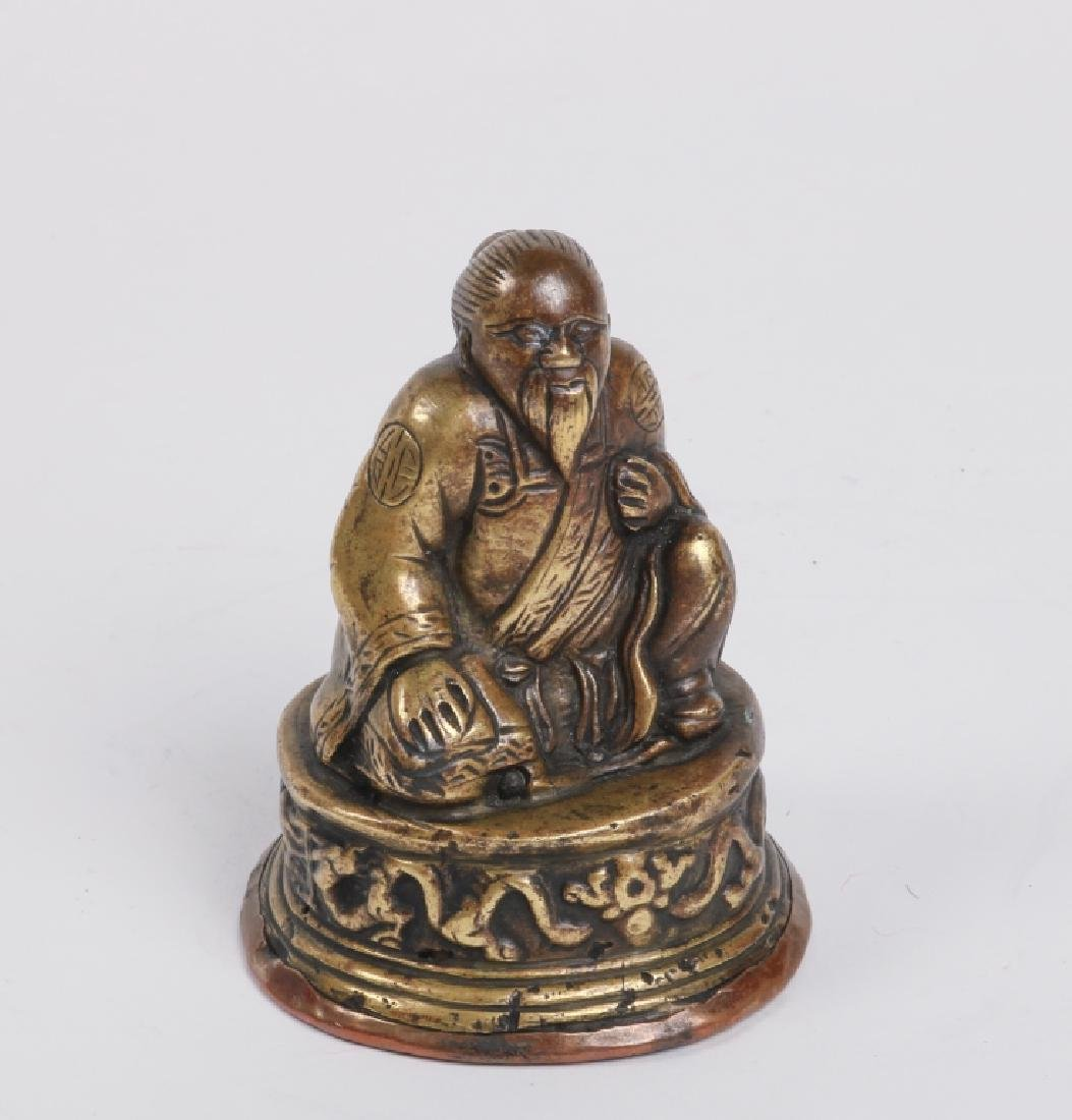 Ming Dynasty lama with silver inlay