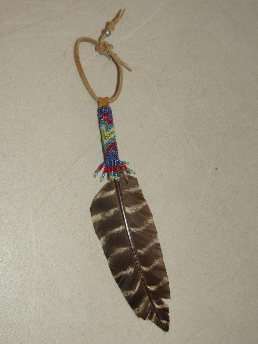 Feather with Native American beaded wrap fob regalia