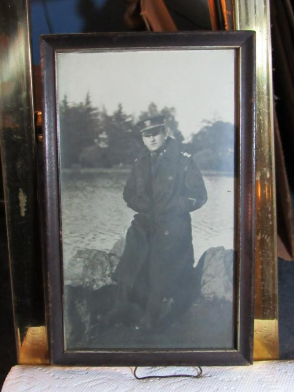 Photo - Man in Uniform Coat by Water