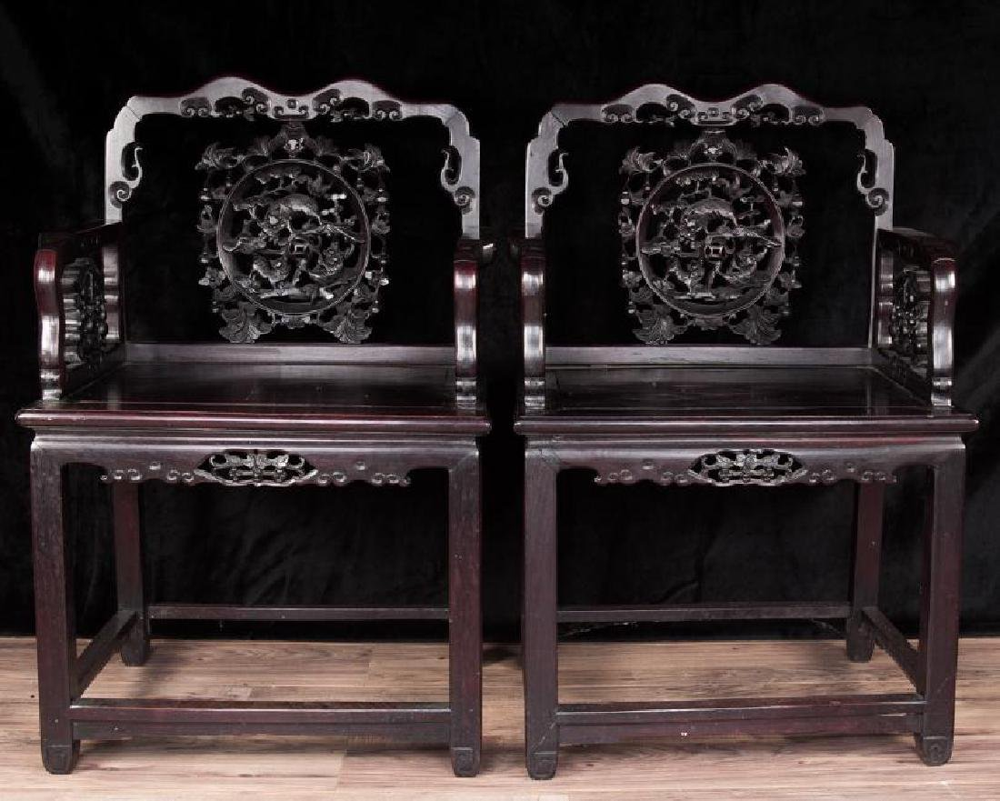 Pair of chinese rose wood arm chairs