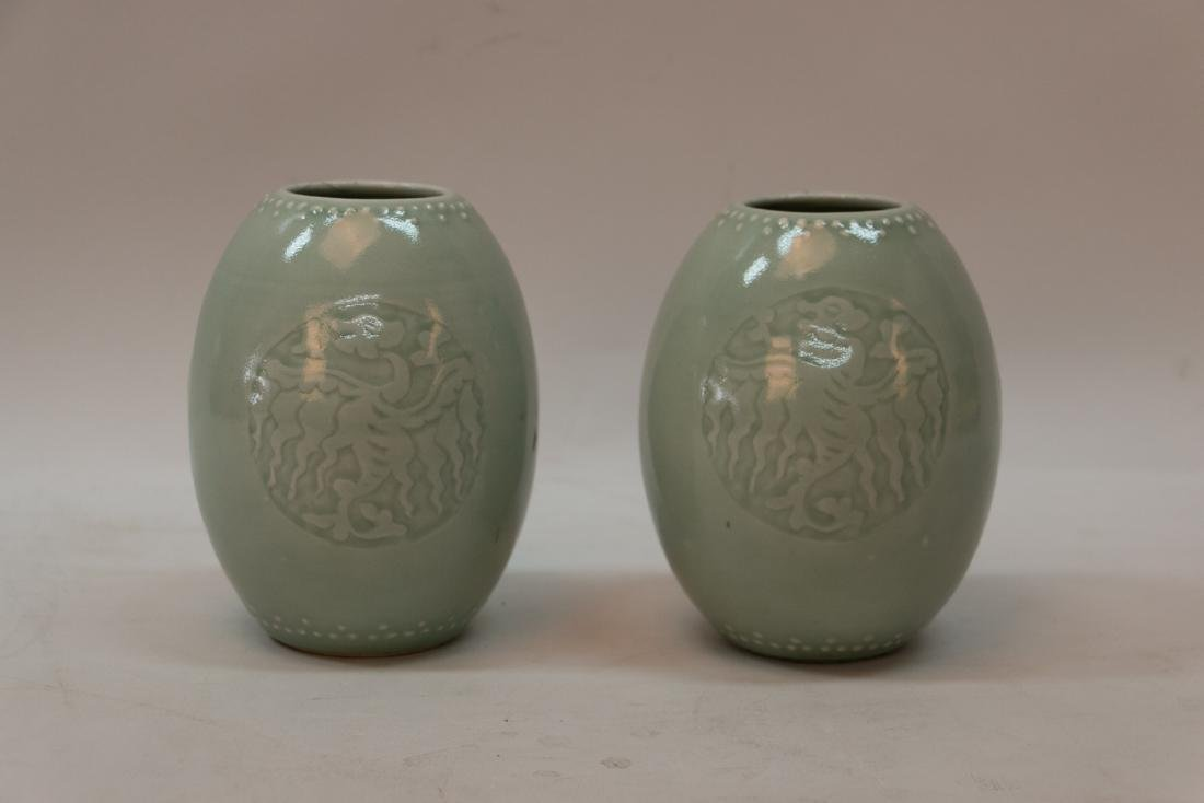 A pair of chinese green glaze porcelain jar