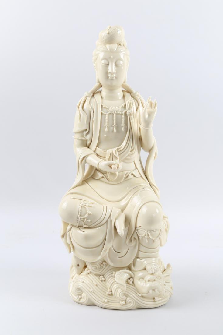 A porcelain GuanYin statue