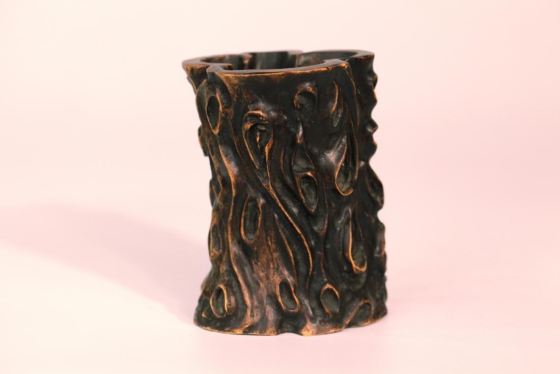 A chinese wood brush pot
