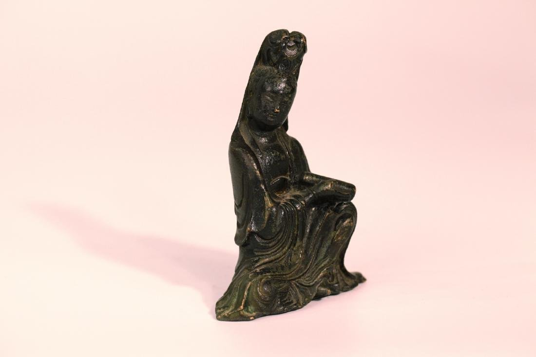 A chinese bronze guanyin statue