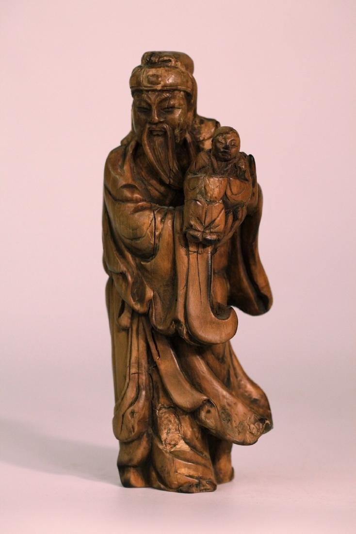 A chinese wood carved decoration
