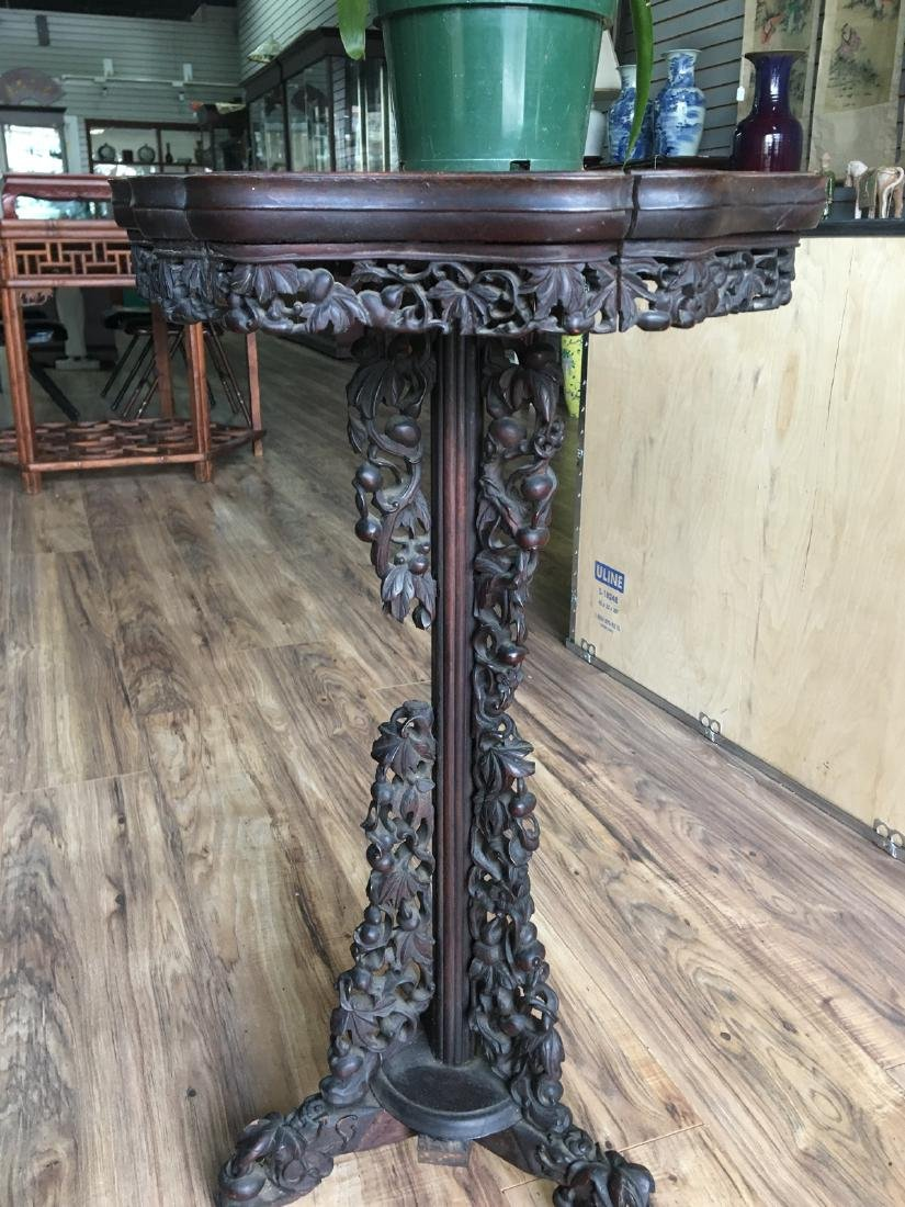 A chinese wood incense table