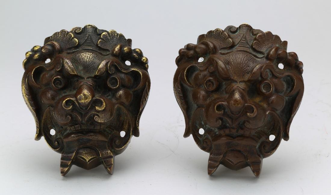 A pair of copper adornment