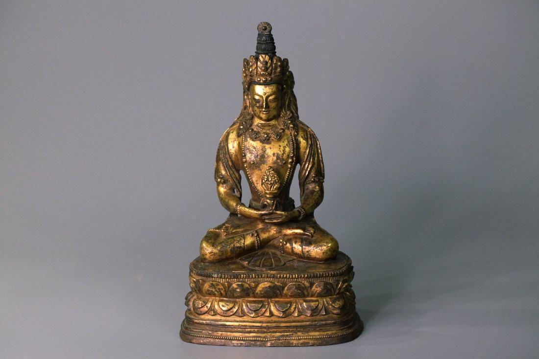 A chinese gilding bronze buddha statue