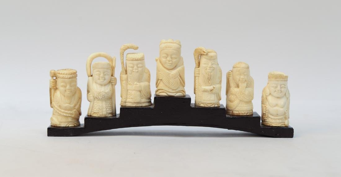 A group of Bone figure statue