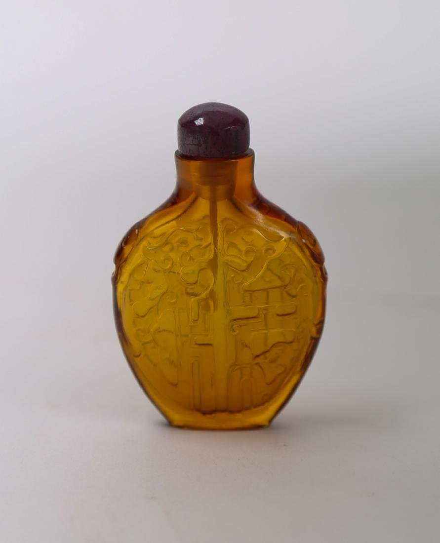 Yellow glass snuff bottle with amethystine cover