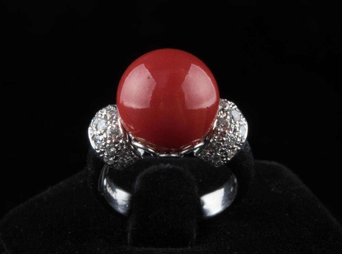 Red ball coral ring. Diamond decoration