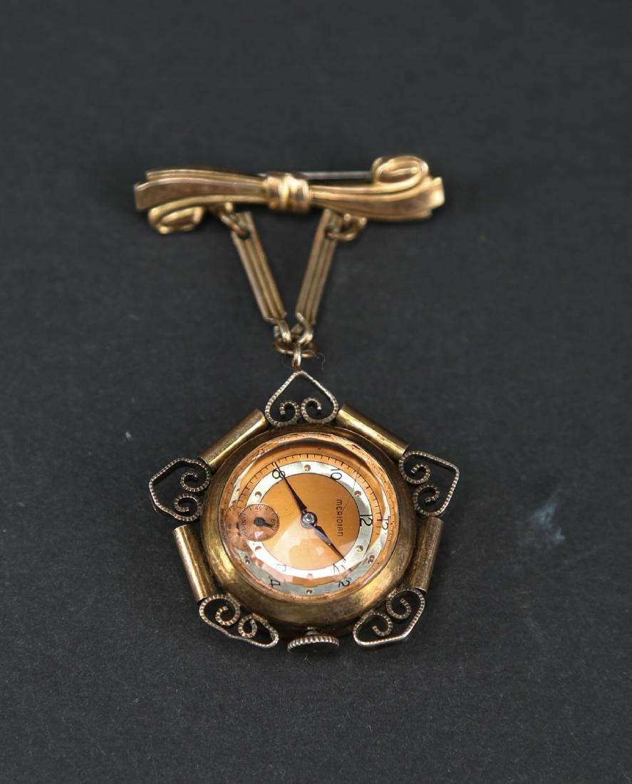 Meridian brooch watch