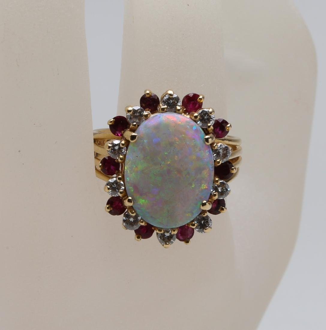 Opal 14k ring beset with diamond and ruby