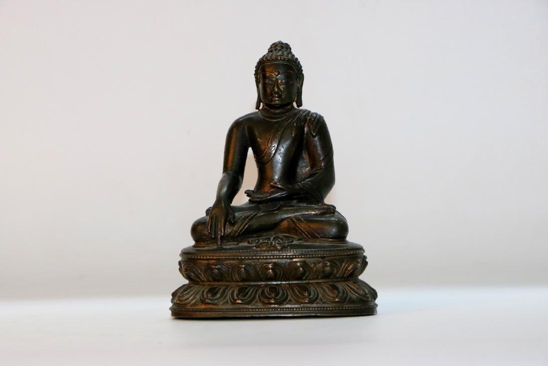 A chinese bronze buddha statue
