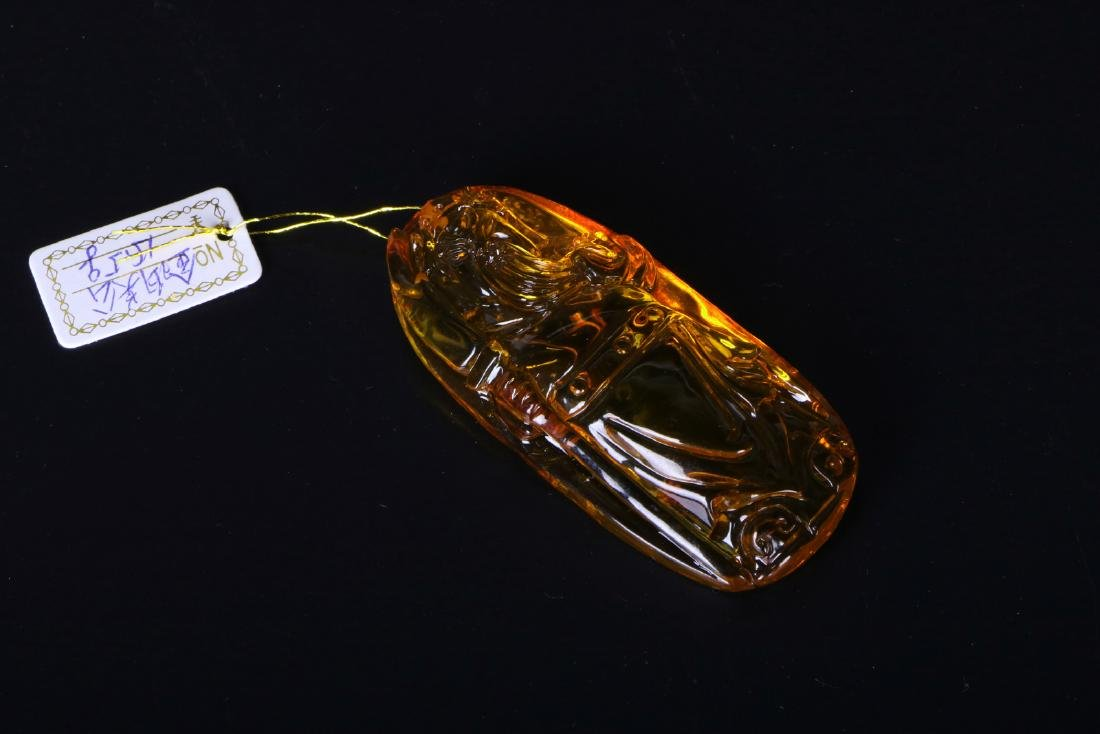 A chinese amber cavred pendant