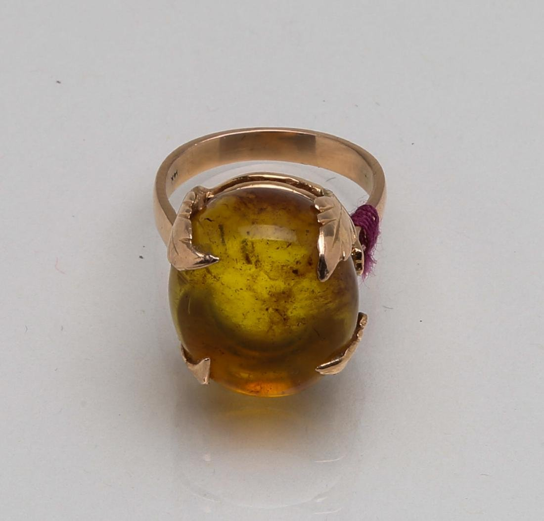 A chinese amber carved pendant