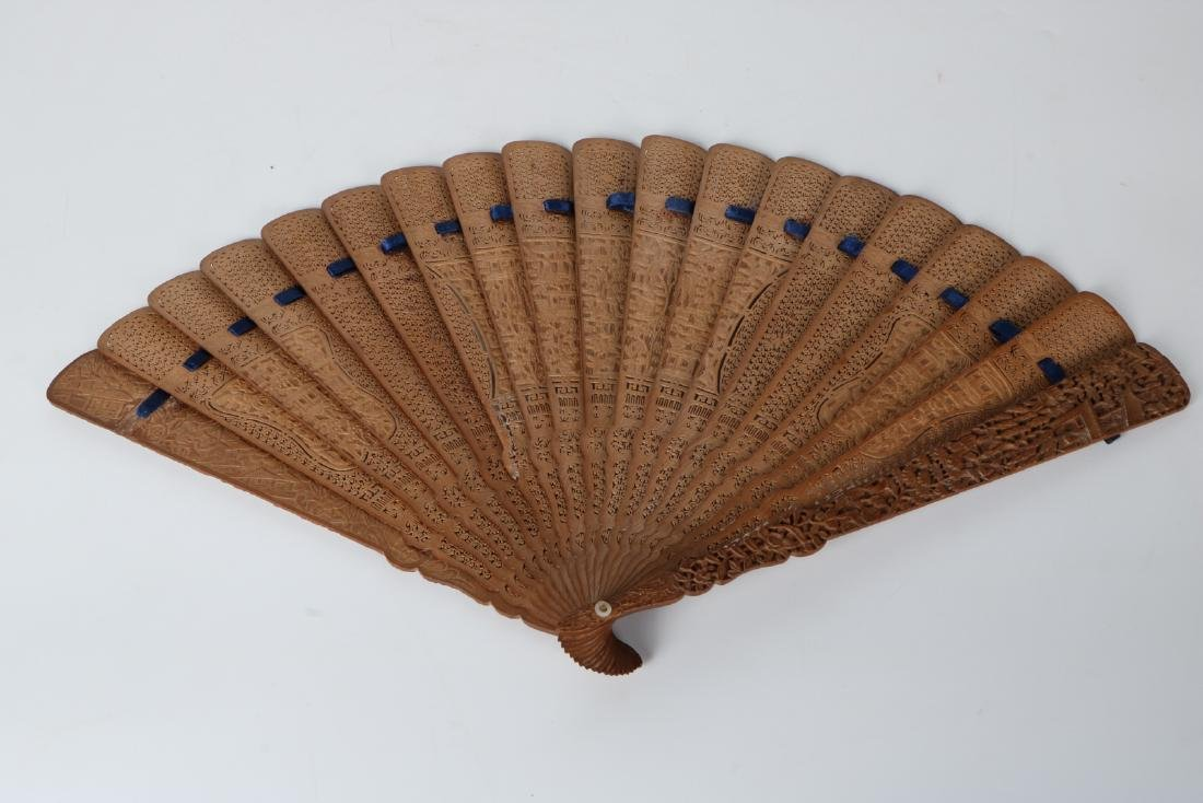 A carved Sandalwood fan