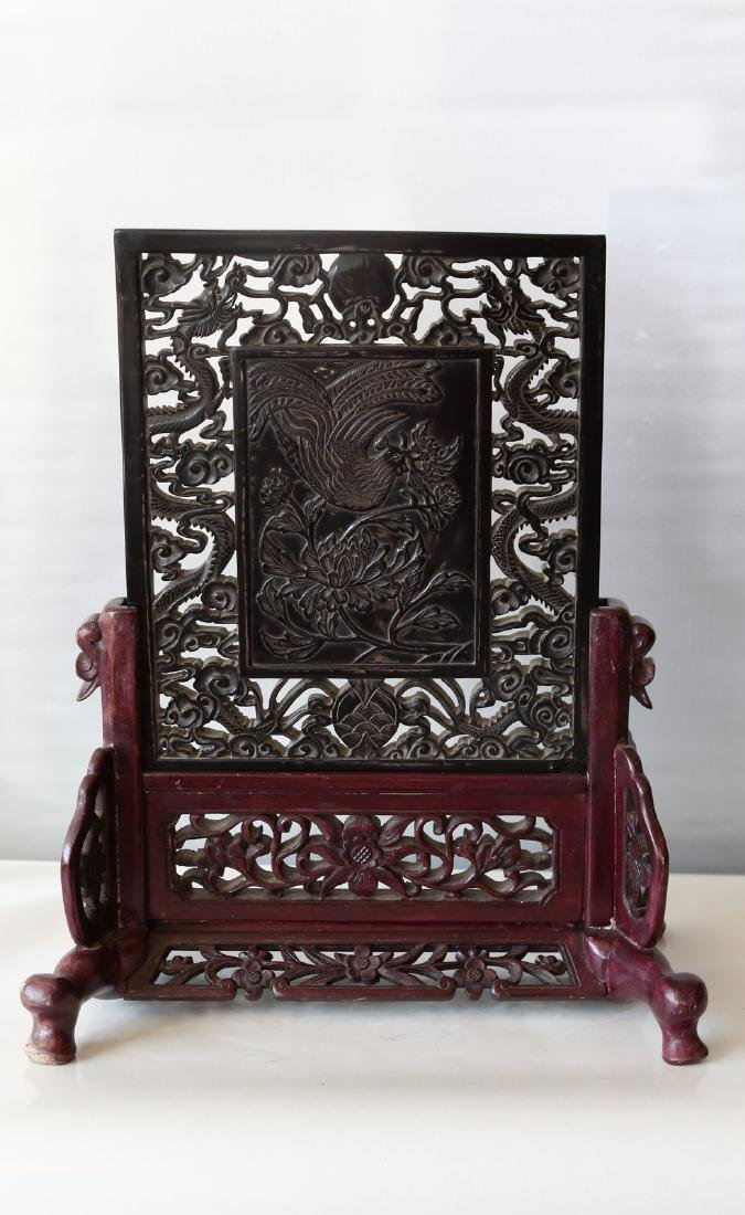 A chinese amber carved screen
