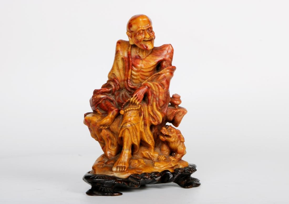 A chinese shoushan stone statue with rosewood base