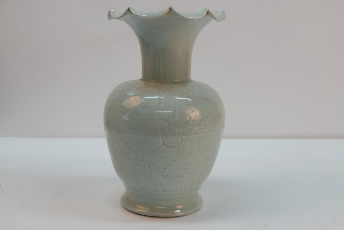 A chinese green white glaze vase