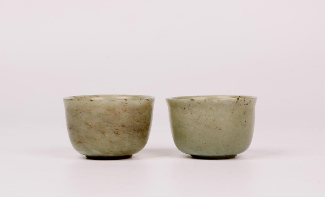 A pair of chinese white jade cups