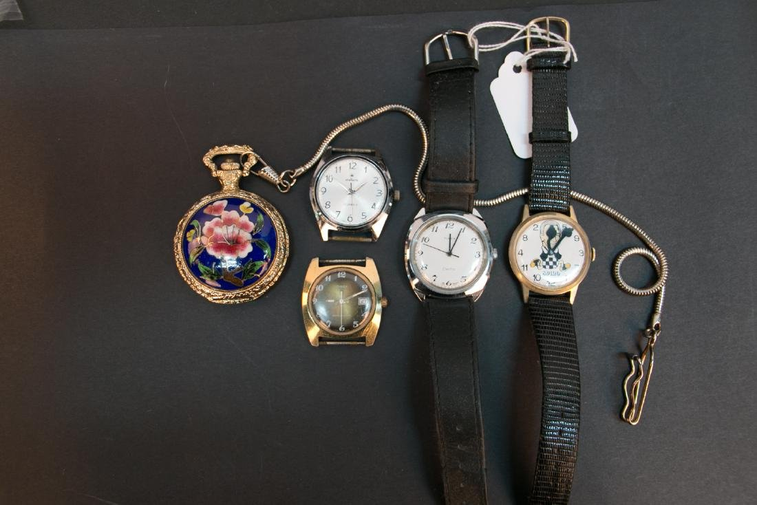 A group of pocket watch and watch