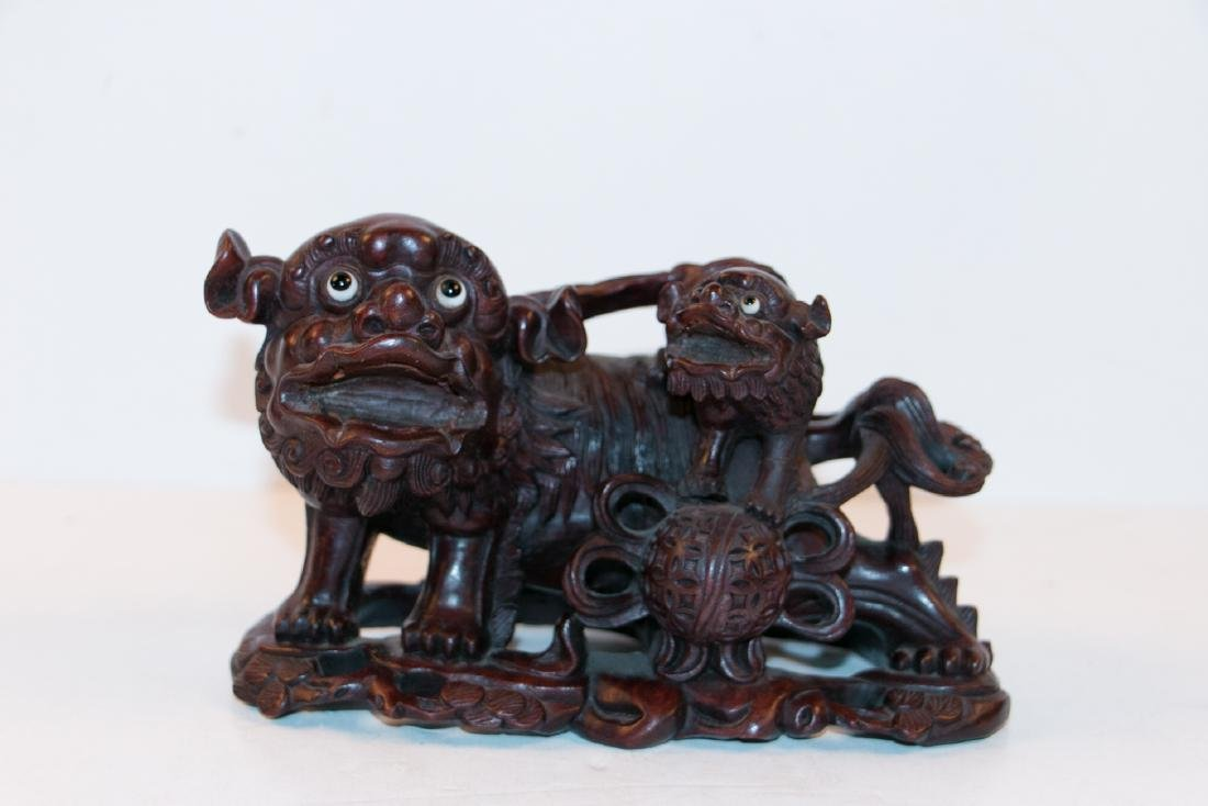 A chinese wood statue