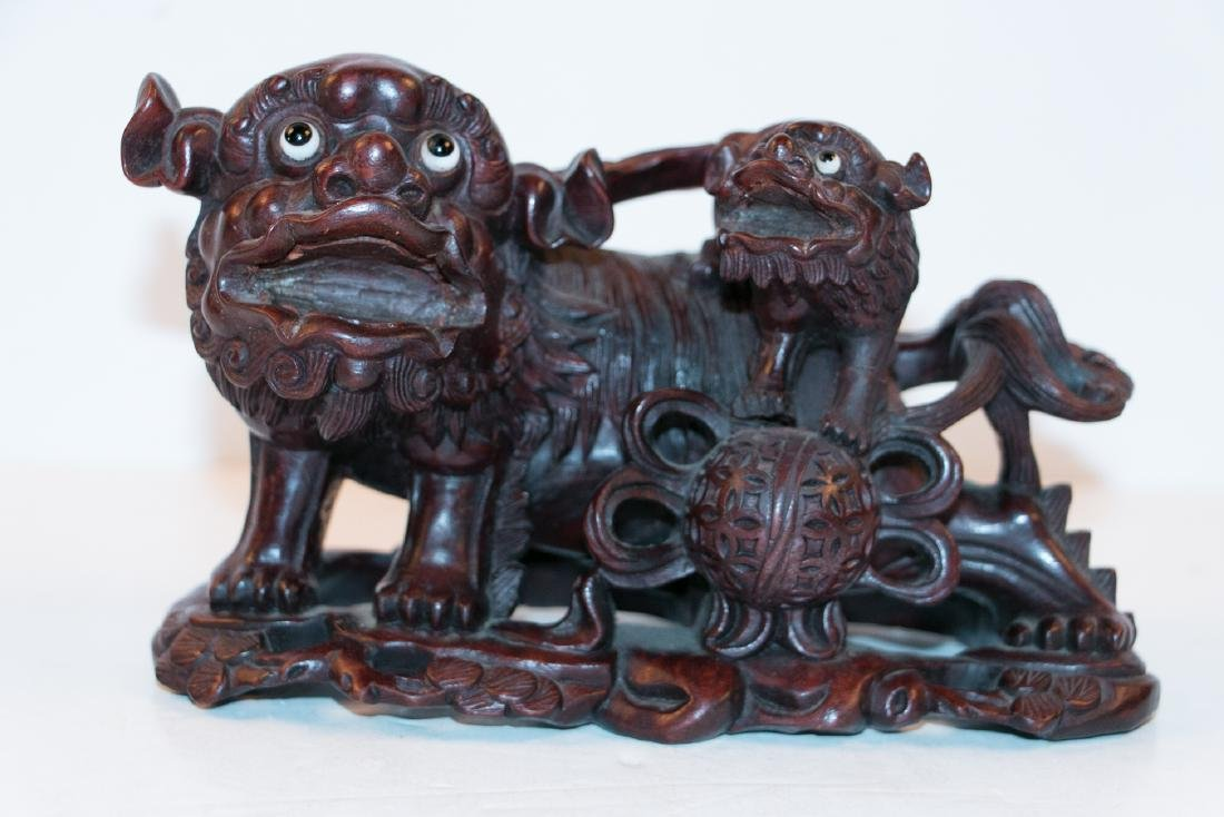 A chinese wood statue - 3