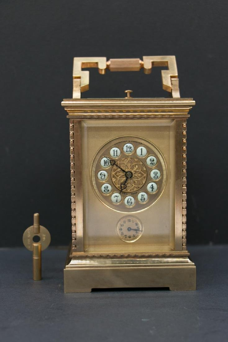 A gilding clock with alarm, track and answer time