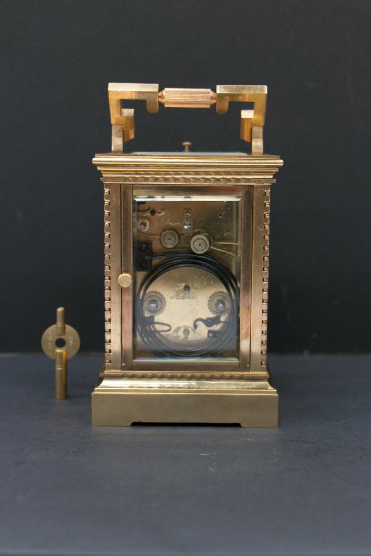 A gilding clock with alarm, track and answer time - 3
