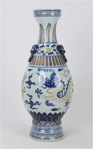 A CHINESE BLUE AND WHITE GILT 'MYSTIC CREATURE' VASE
