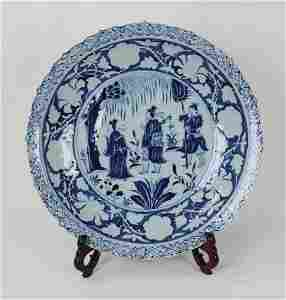 A CHINESE YUAN DYNASTY BLUE AND WHITE 'FIGURE' PLATE,